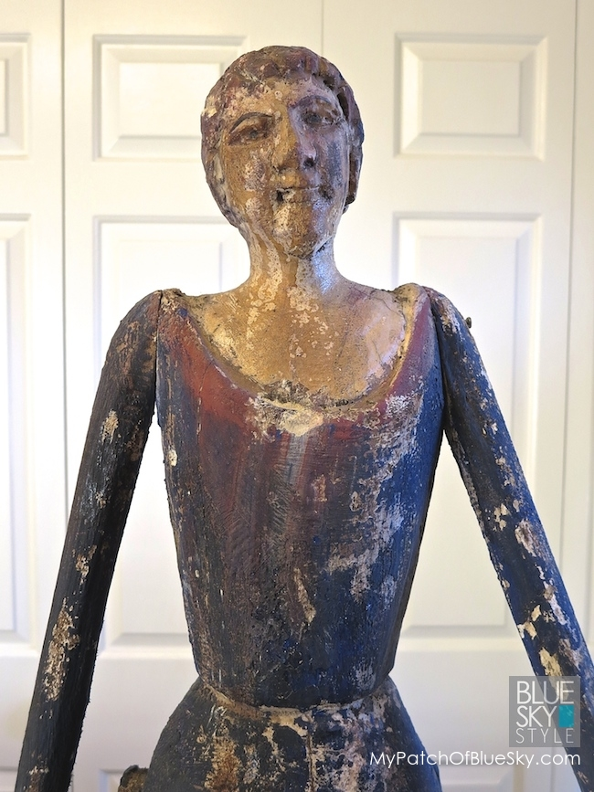 Gilding a carved wooden lady