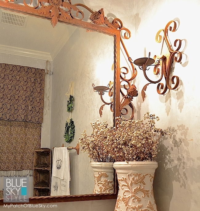 Small rustic touches in a tiny powder room make it special.
