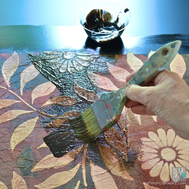 Layer texture and pattern using Wood Icing® Textura Paste and decorative dinner napkins