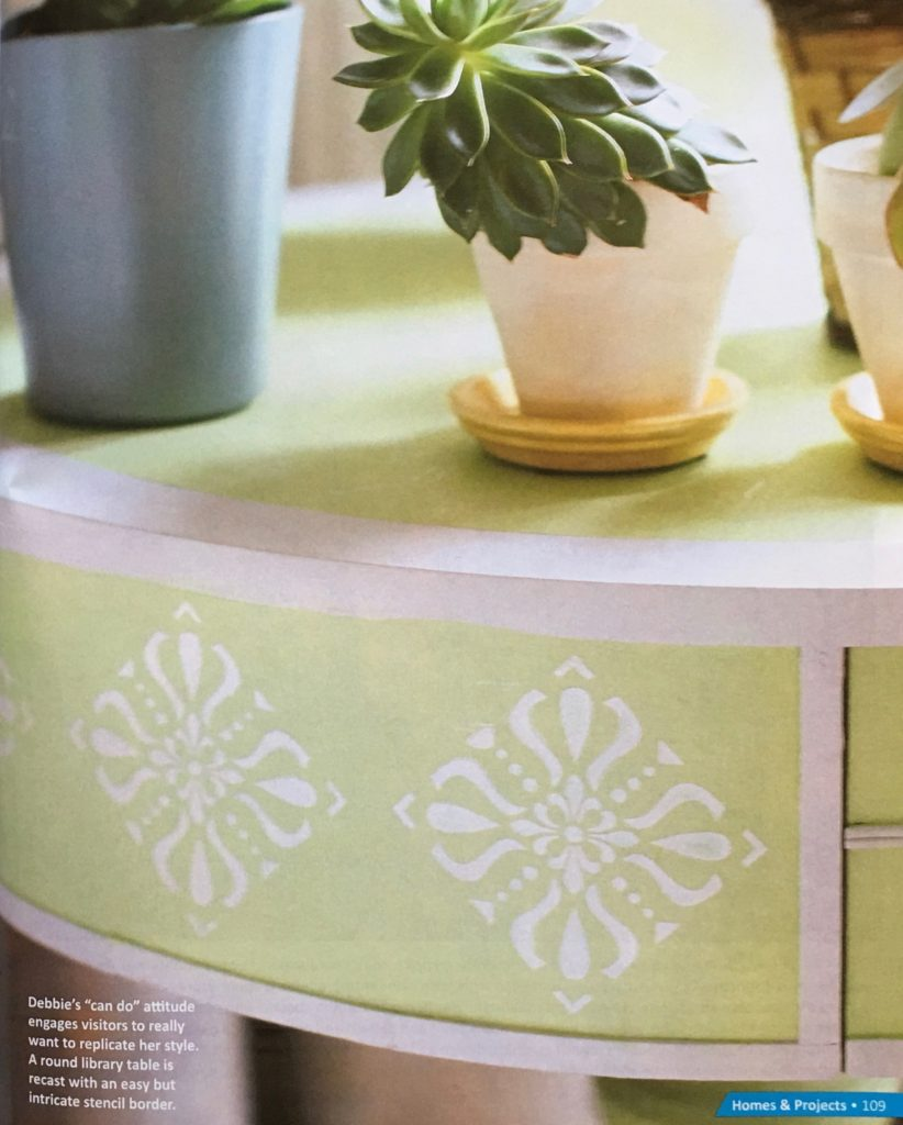 A round, painted and stenciled table by Debbie Dion Hayes | Featured in Upstyled Home