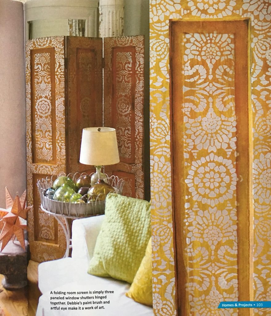 Stenciled living room screen in Upstyled Home, by Debbie Dion Hayes, using Modern Masters Metal Effects and Royal Design Studio stencil