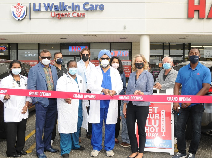 Nassau County Executive Laura Curran helps Dr. Inderpal Chhabra cut the ribbon on the new LI Walk-in Care Center