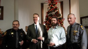 From left are Sheriff Keith O. Wood, Director John Born, Brian Castner, Telecommunications with Ohio Emergency Management Agency and Colonel Paul A. Pride, Superintendent of the Ohio Highway Patrol. Photo by Carrie Gloeckner