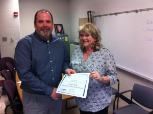 """Tony Deem, Southern Local Superintendent, recently presented Vicki Northup with a certificate and gift from the Ohio Association for Elementary School Administrators (OAESA) and its  """"Secretary of the Year"""" Award. Northup was a finalist among this year's nominations."""