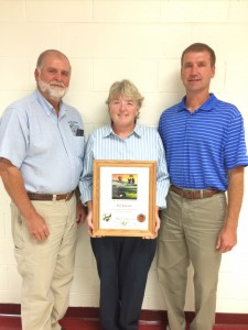 Kim Romine, center, Pomeroy, was recognized by the Ohio Department of Natural Resources-Division of Soil and Water Resources, for her six years of service as a member of the Meigs Soil and Water Conservation District Board of Supervisors. She is shown with Meigs SWCD program administrator Steve Jenkins, left, and Rob Hamilton, program specialist with ODNR-Division of Soil and Water Resources.