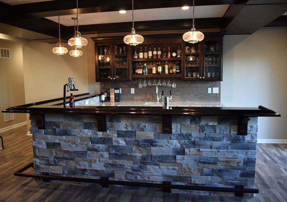 Basement wet bar with custom bar top.