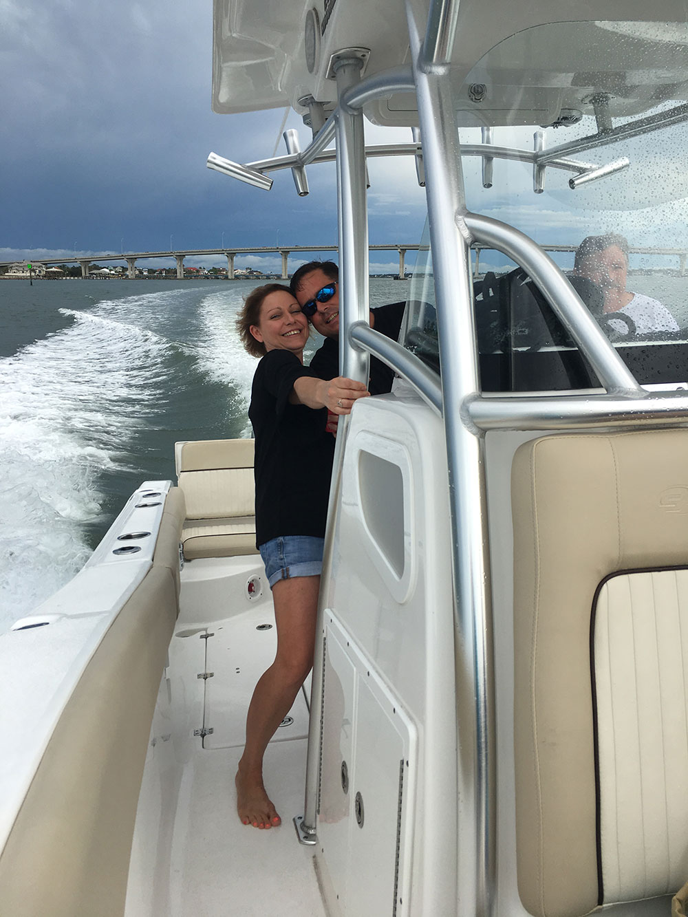 chris worth and his wife smiling on the boat in the intracoastal water