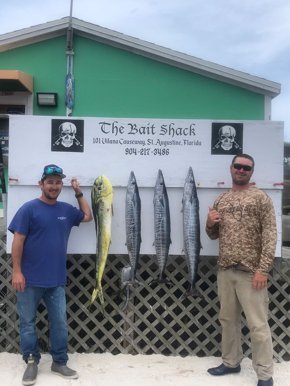 two men showcasing their 4 fish catch at The Bait Shack