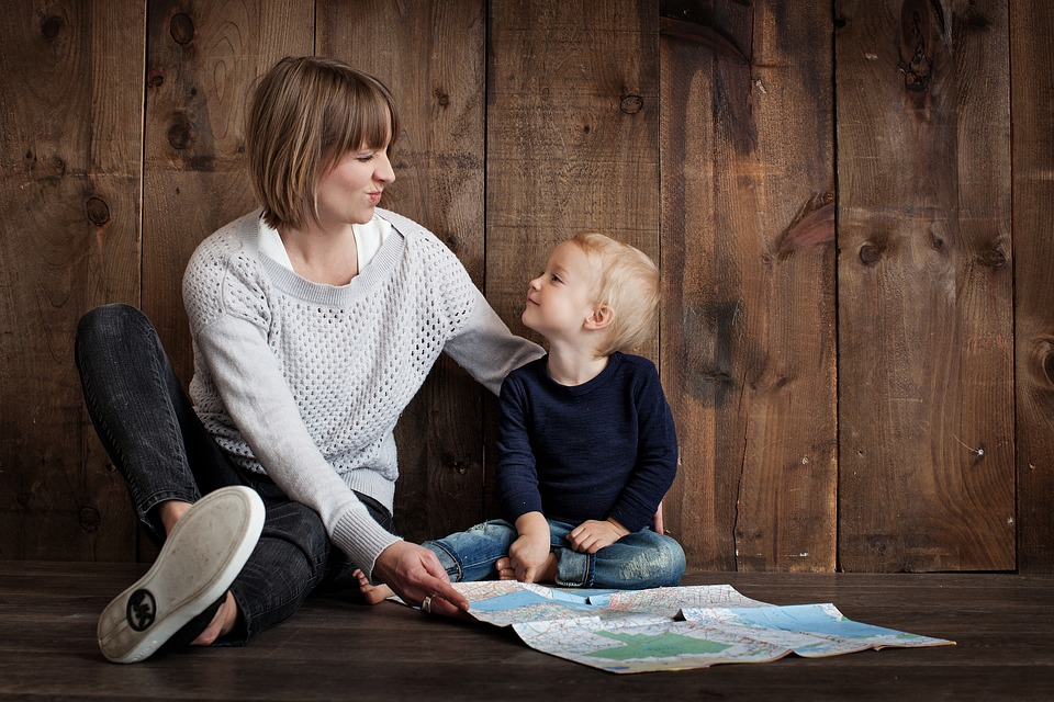 parent child hanging out on the floor - Keeping Costs Under Control Through Divorce - Custody Issue