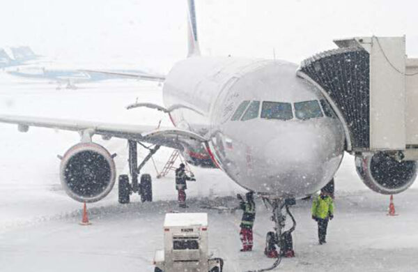 Plane on the ground in the snow