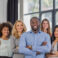 African American Businessman Boss With Group Of Business People In Creative Office, Successful Mix Race Man Leading Businesspeople Team Stand Folded Hands, Professional Staff Happy Smiling