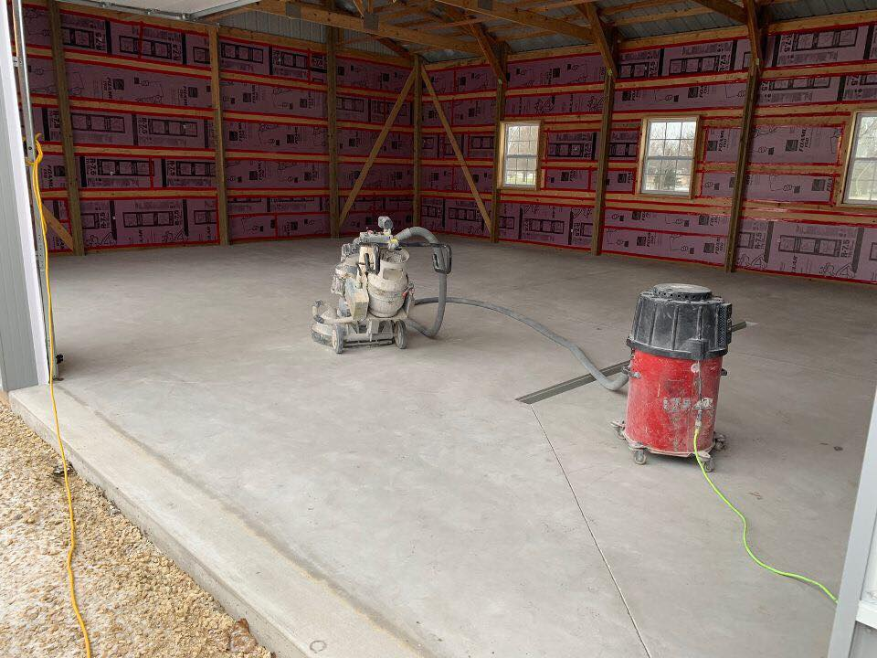Here you can see our freshly sanded concrete floors. We've utilized a commercial sander and shop vac to prep and clean our job site for our Vinyl Chip System.