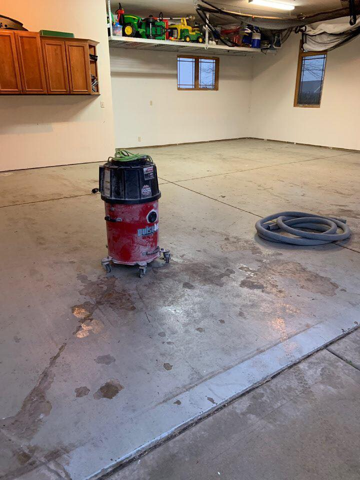 Here you can see our shop vac that we use to vacuum any loose debris. This is a crucial step that we complete prior to installing our Polyurea Base Coat!
