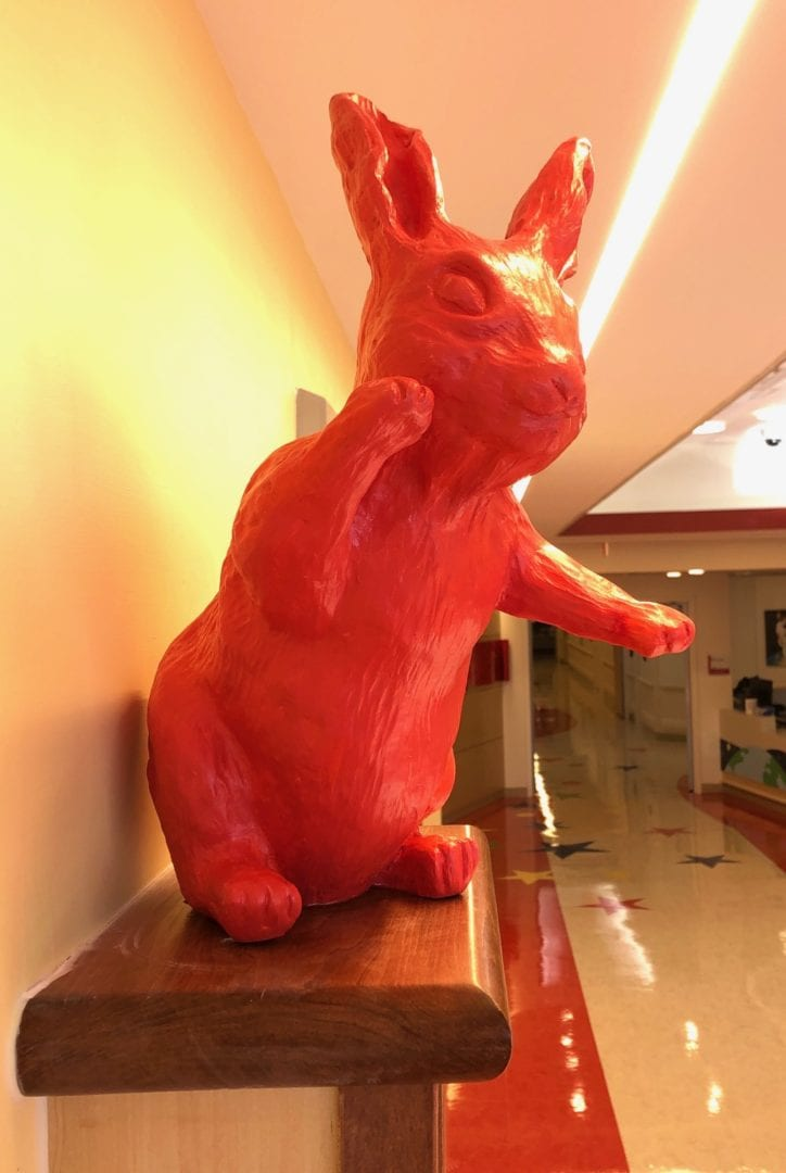 Another bunny by the elevator of Vanderbilt Children's Hospital 11th floor--pointing at the mural. All art by Rachael McCampbell © 2020