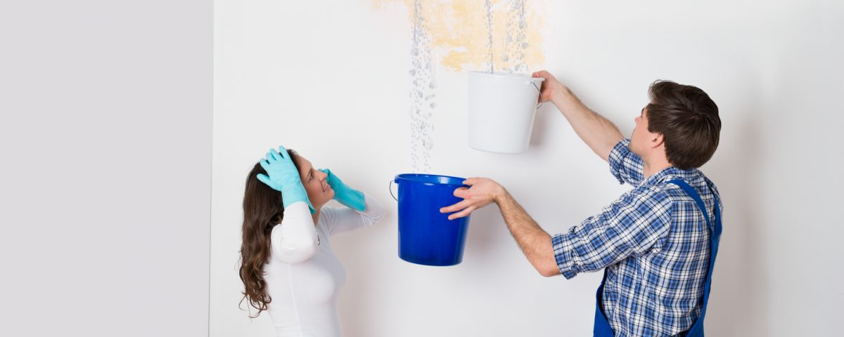 woman collecting water from bucket