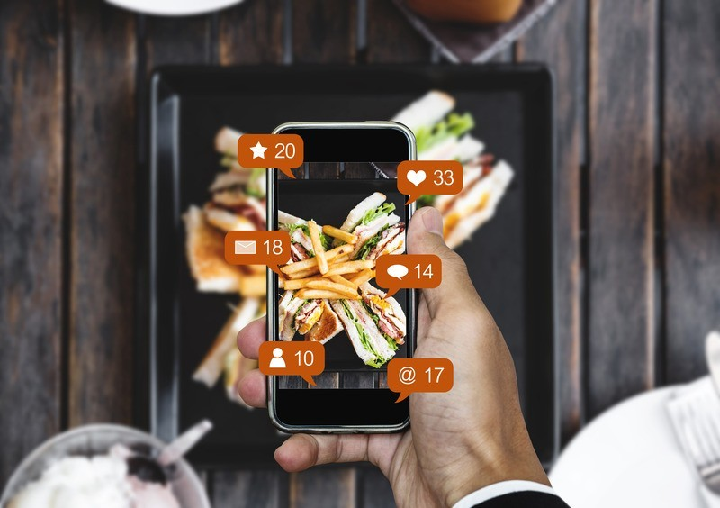 Canva Taking food photograph by mobile smart phone and sharing on social media social network with notification icons