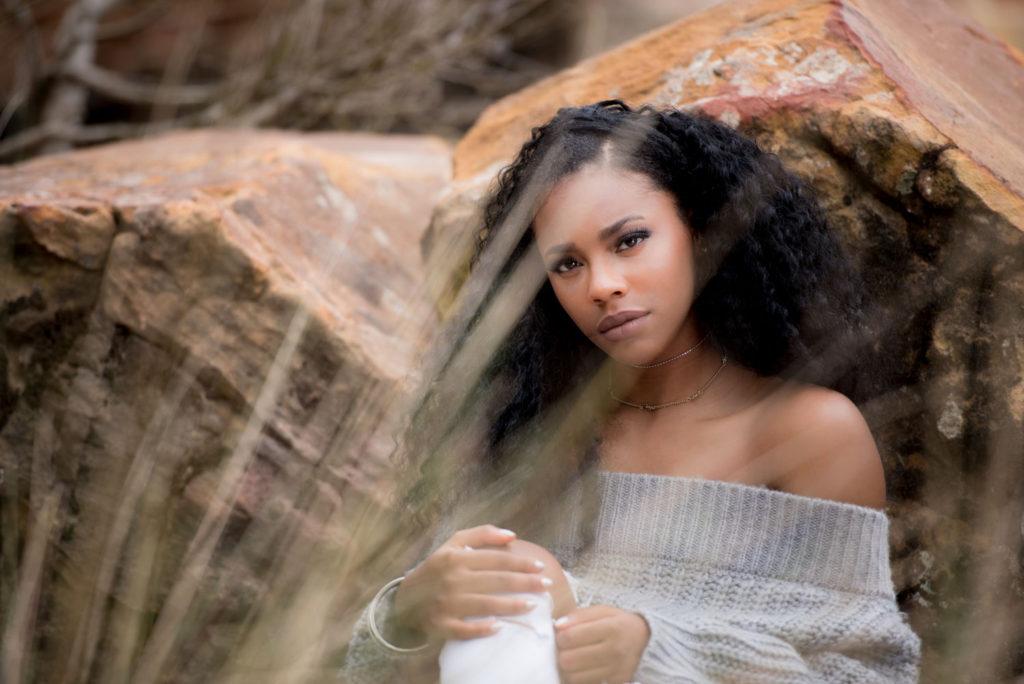 Modelesque senior poses in desert scene in south Louisiana