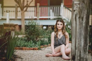 Kaitlyn Fashionista set in rustic backdrop
