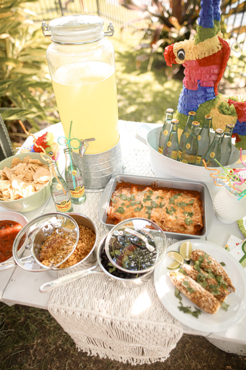 Enchiladas, Mexican street corn, black beans, rice and more~ recipes are on the blog. More details for an ffordable, backyard fiesta with the family and a friends is on dashingdarlin.com.
