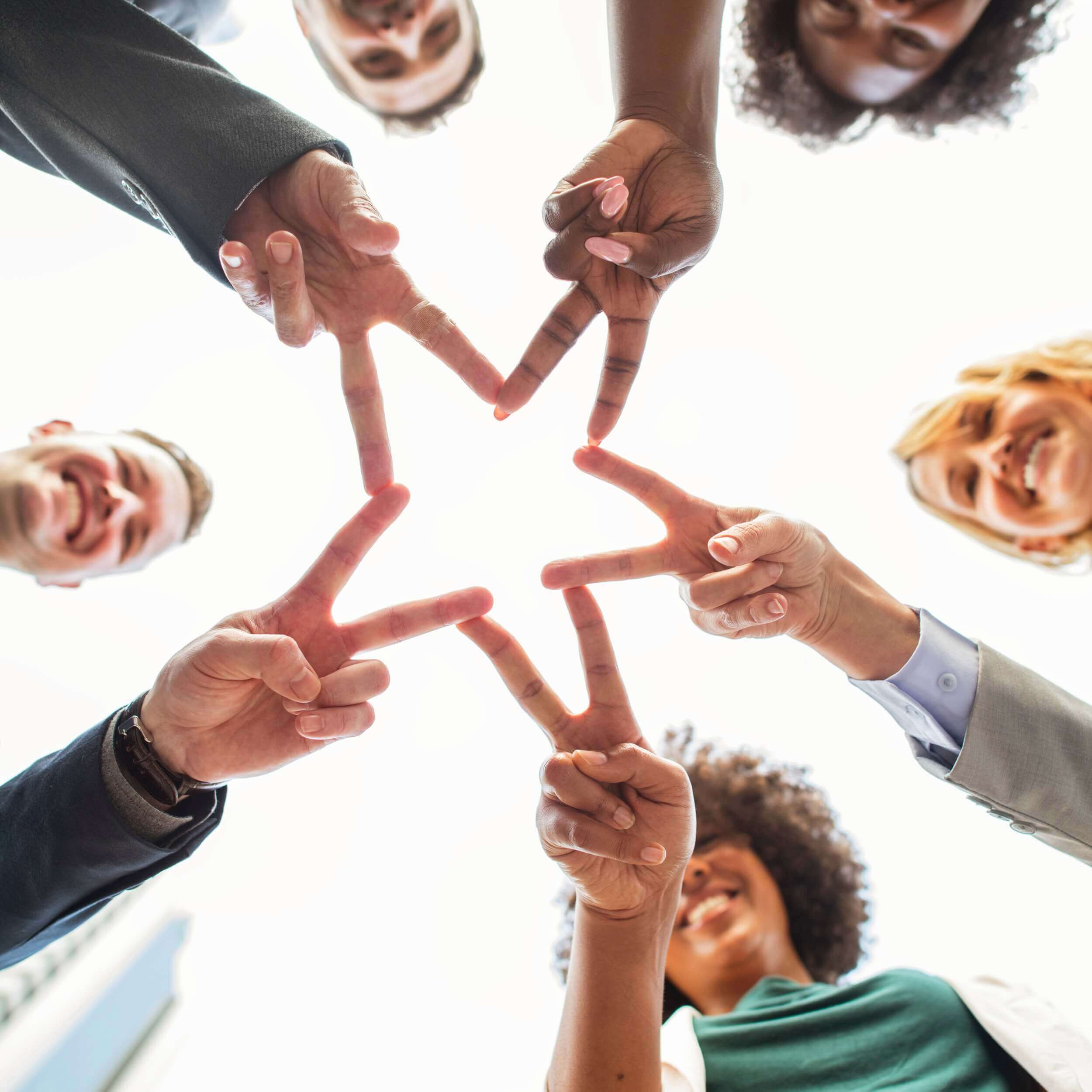 Business Adults Teamwork to Form a Star