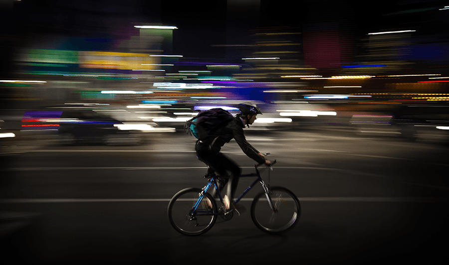 Bicyclist on busy street