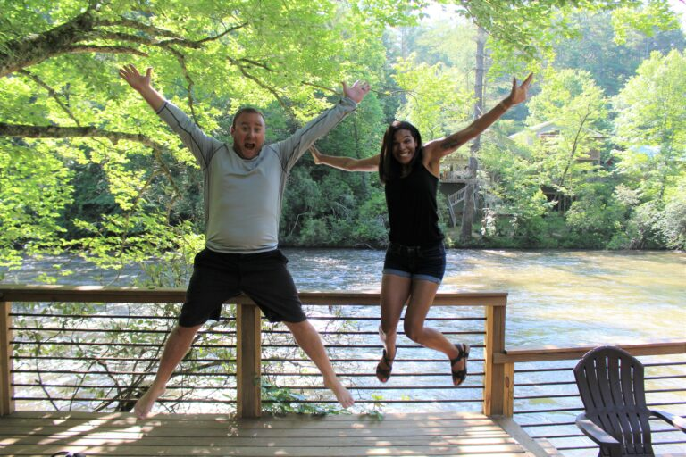 two people jumping for joy