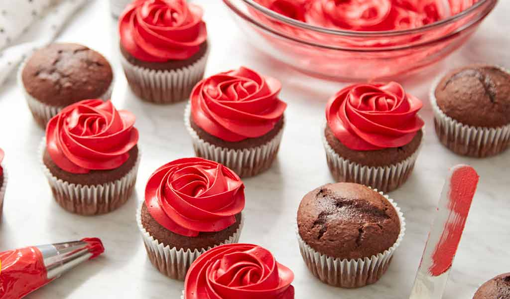 chocolate cupcakes with red buttercream frosting