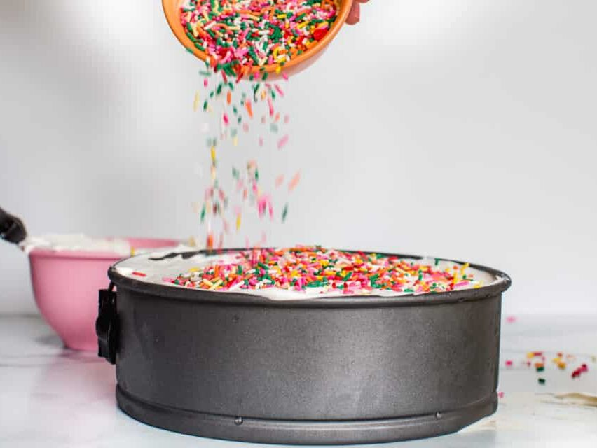 sprinkles pouring on top of cake