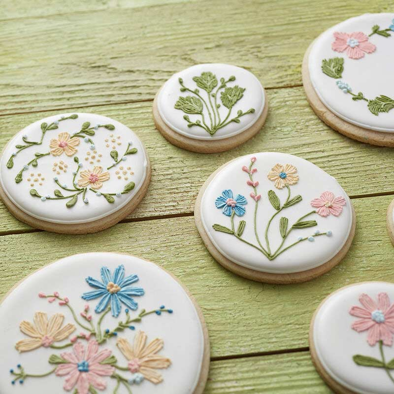 cookies decorated with flowers and vines