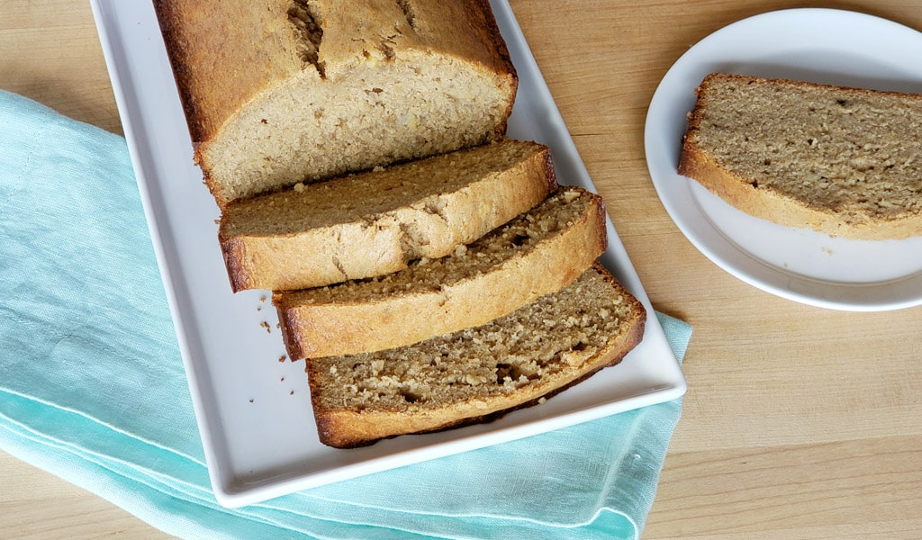 banana bread sliced and served on a plate