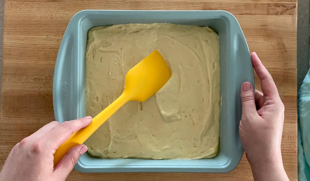 pouring batter into a pan