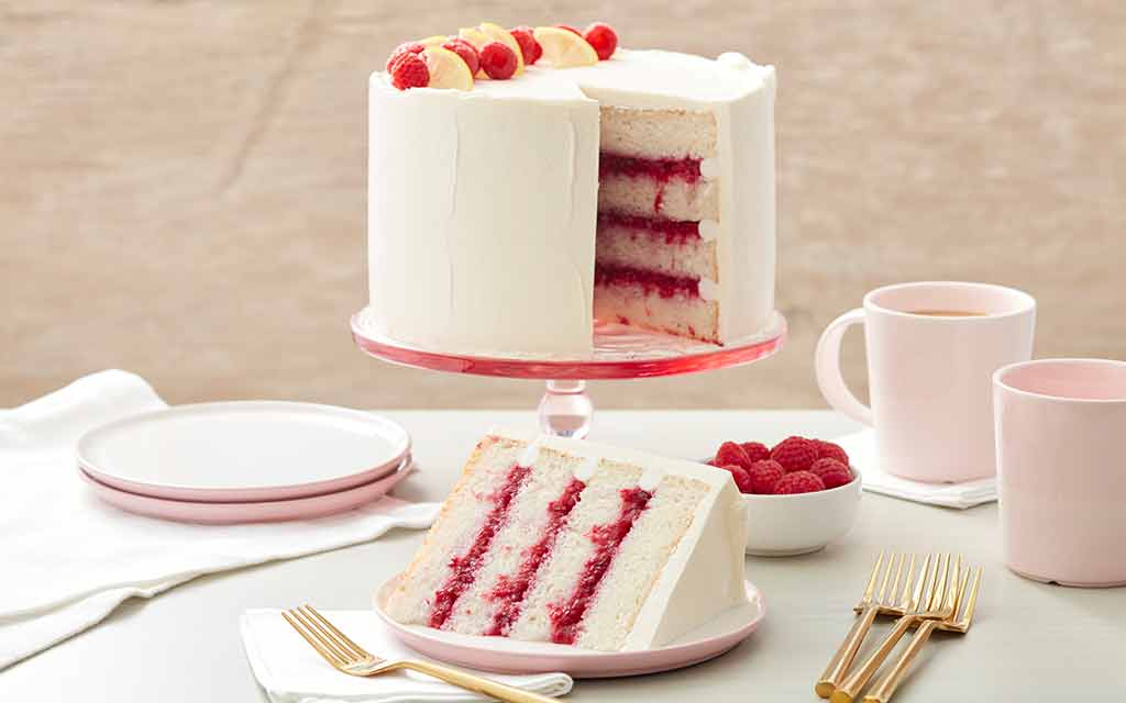 raspberry filled cake frosted with white buttercream frosting