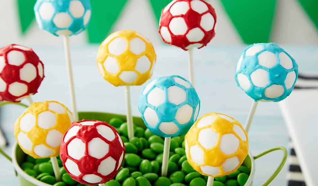 red blue and yellow soccer ball cake pops