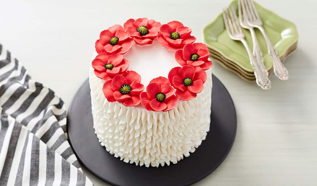 White cake with red poppies