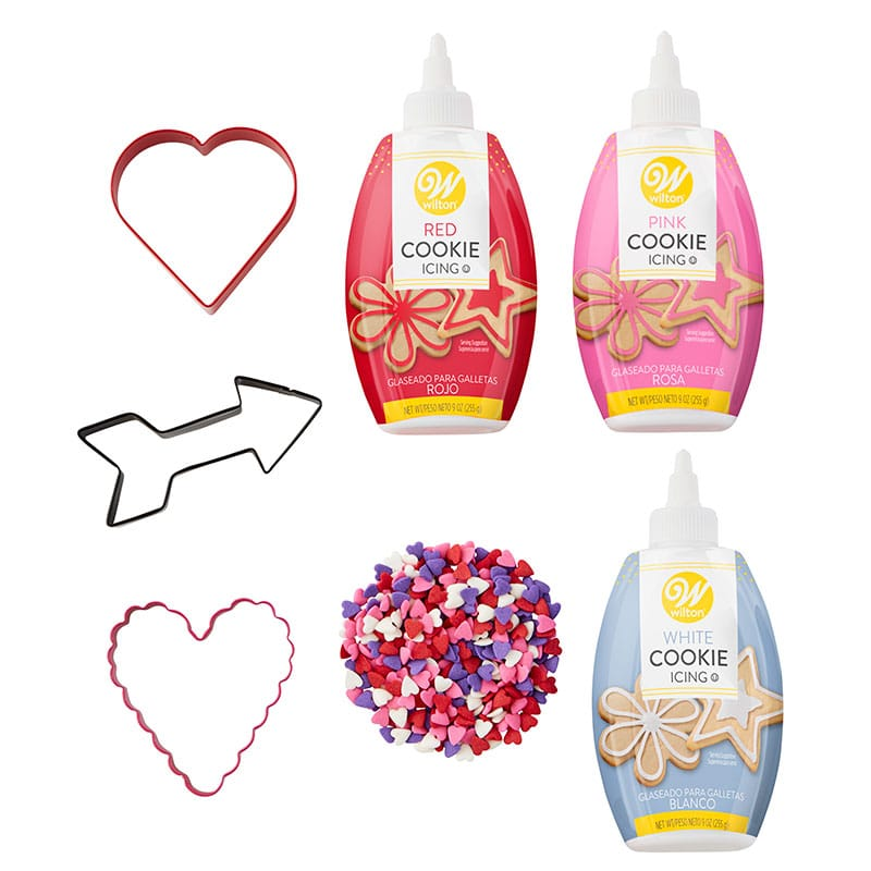 Valentine cookie decorating kit - Pink, red, and white cookie icing, Valentine sprinkles, and heart and arrow cookie cutters.