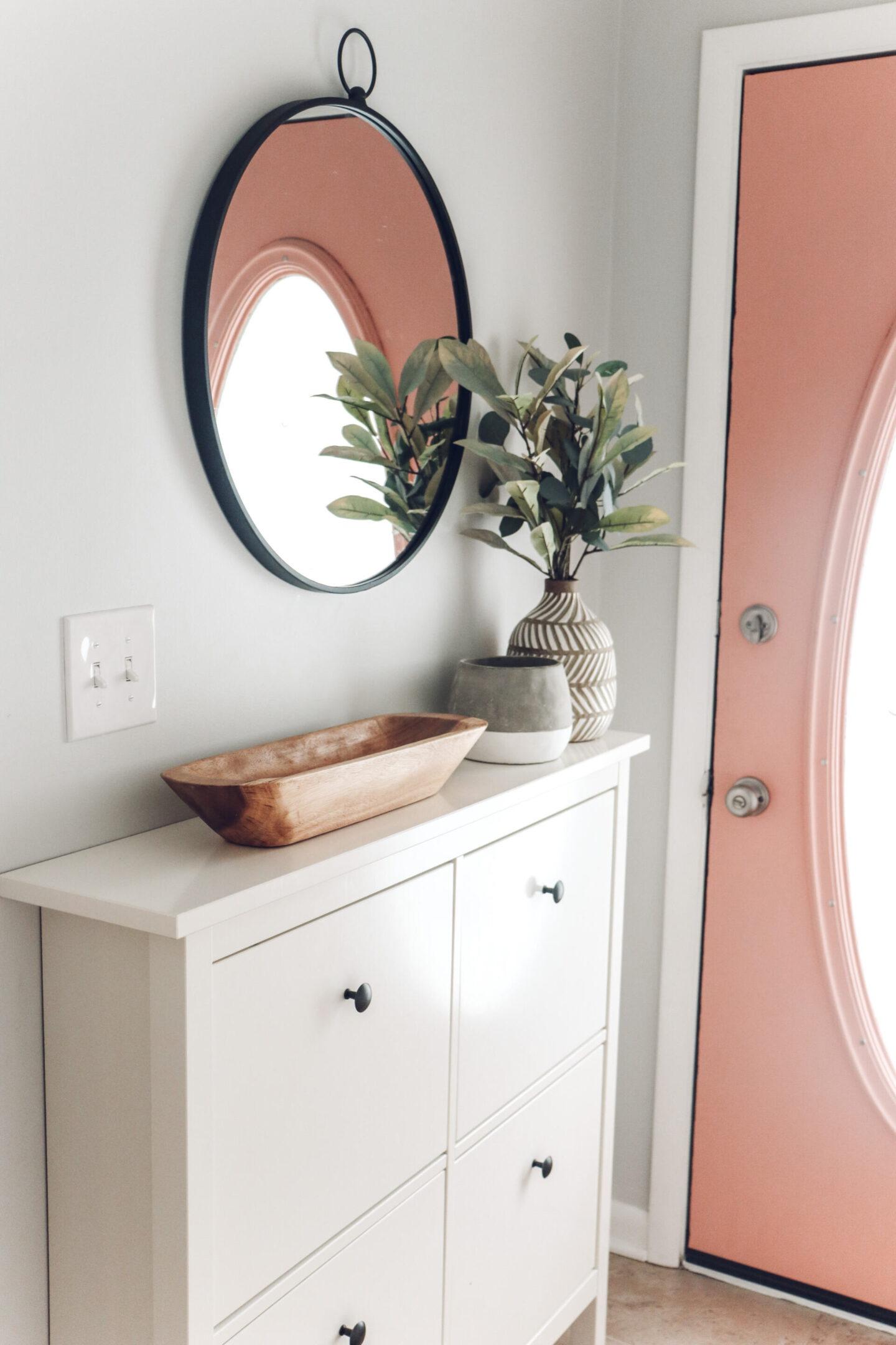 small entryway pink door