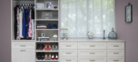 White finish drawers within custom storage closet