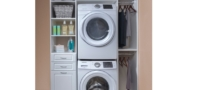 white finish custom storage within laundry room