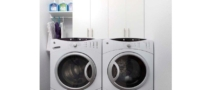 Custom white shelves within laundry room