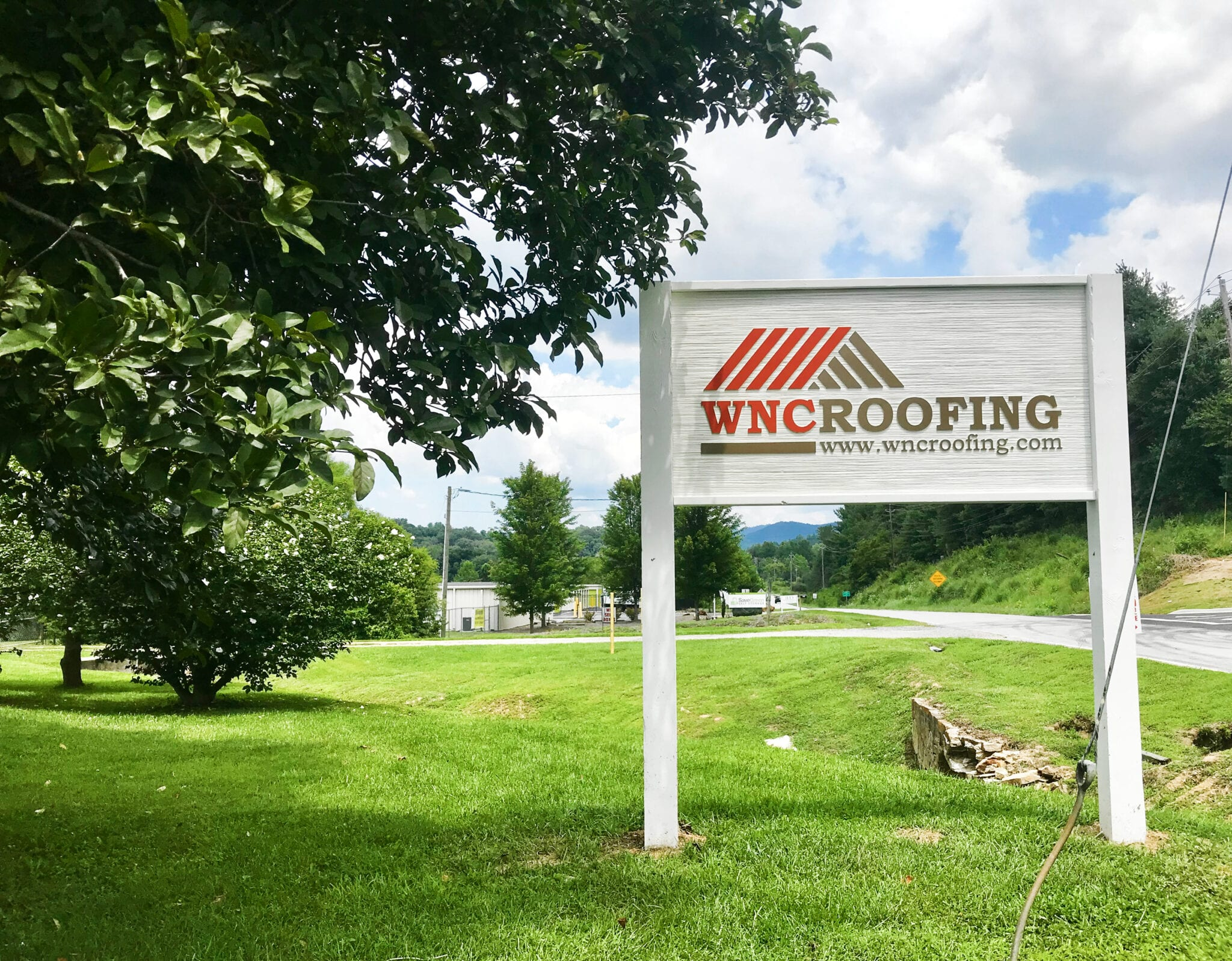 New WNC Roofing office sign standing on front lawn