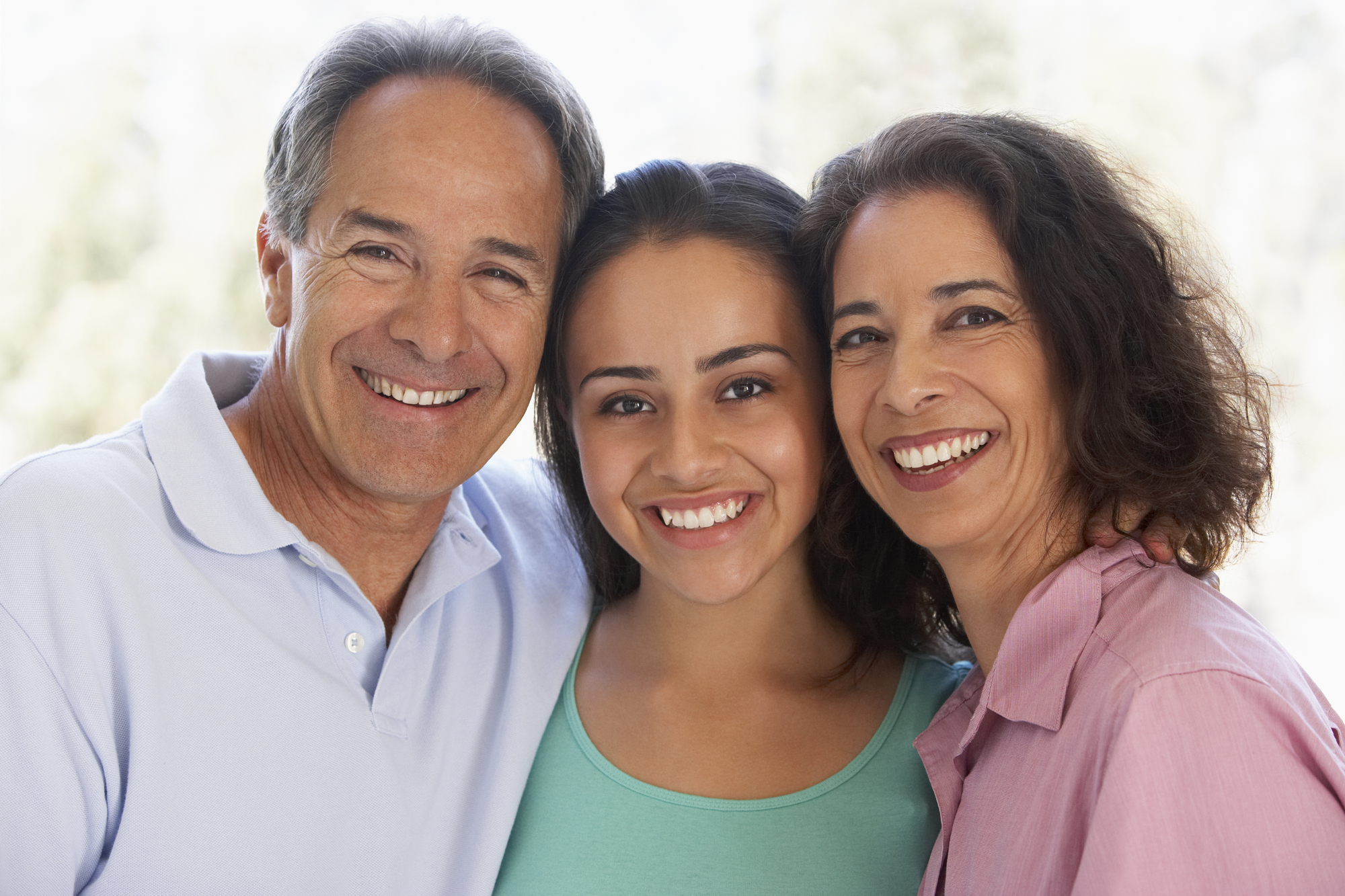 Couple With Their Teenage Daughter