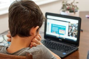 picture of child on a laptop
