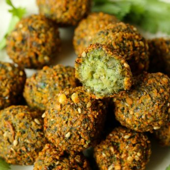 This Moroccan-inspired falafel recipe delivers a delicately crispy falafel on the outside with a soft buttery interior. Herbed and spiced to perfection, they are super easy to make. Eat them on their own, or in a falafel salad or as a snack.