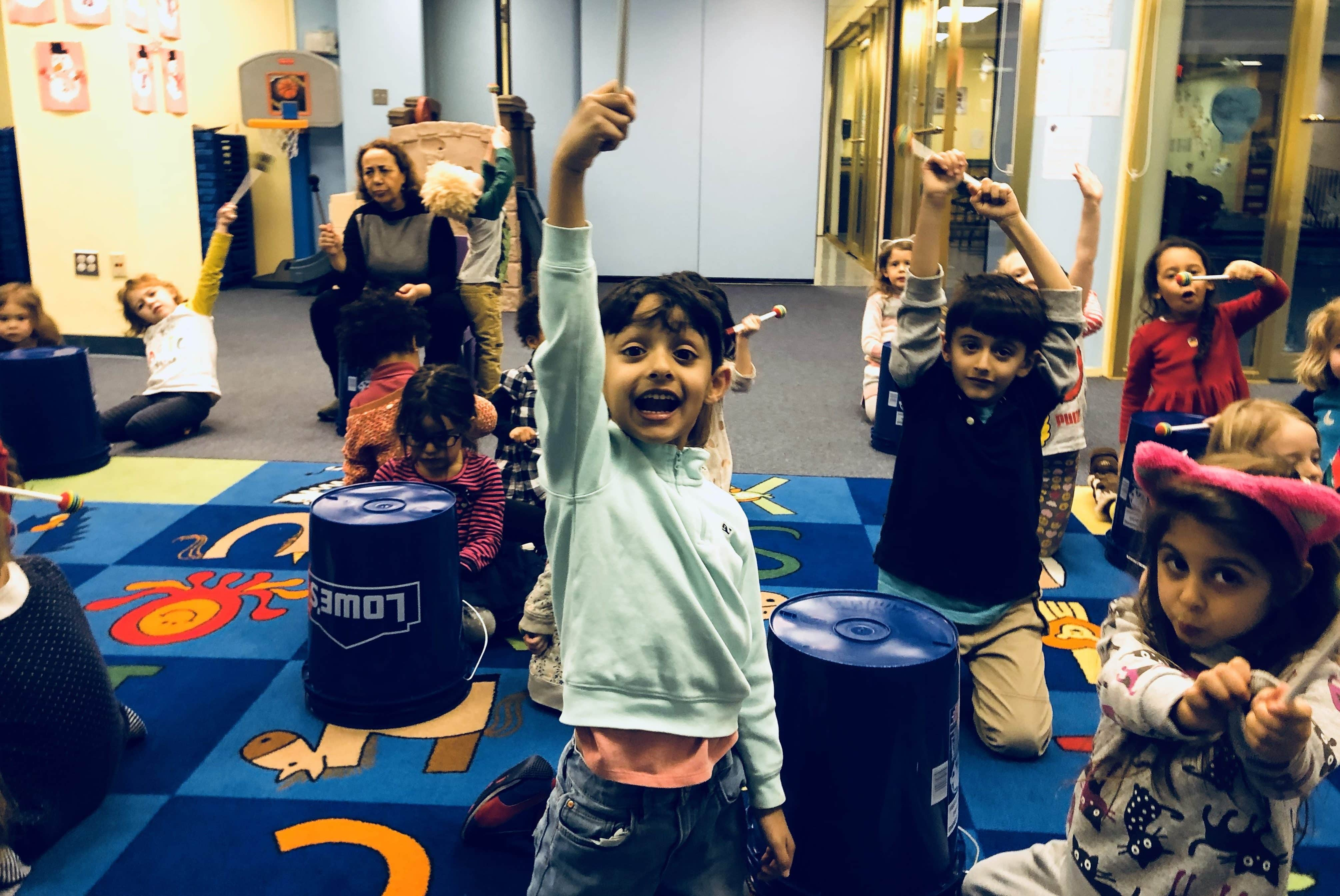 Students Smiling Playing Buckets