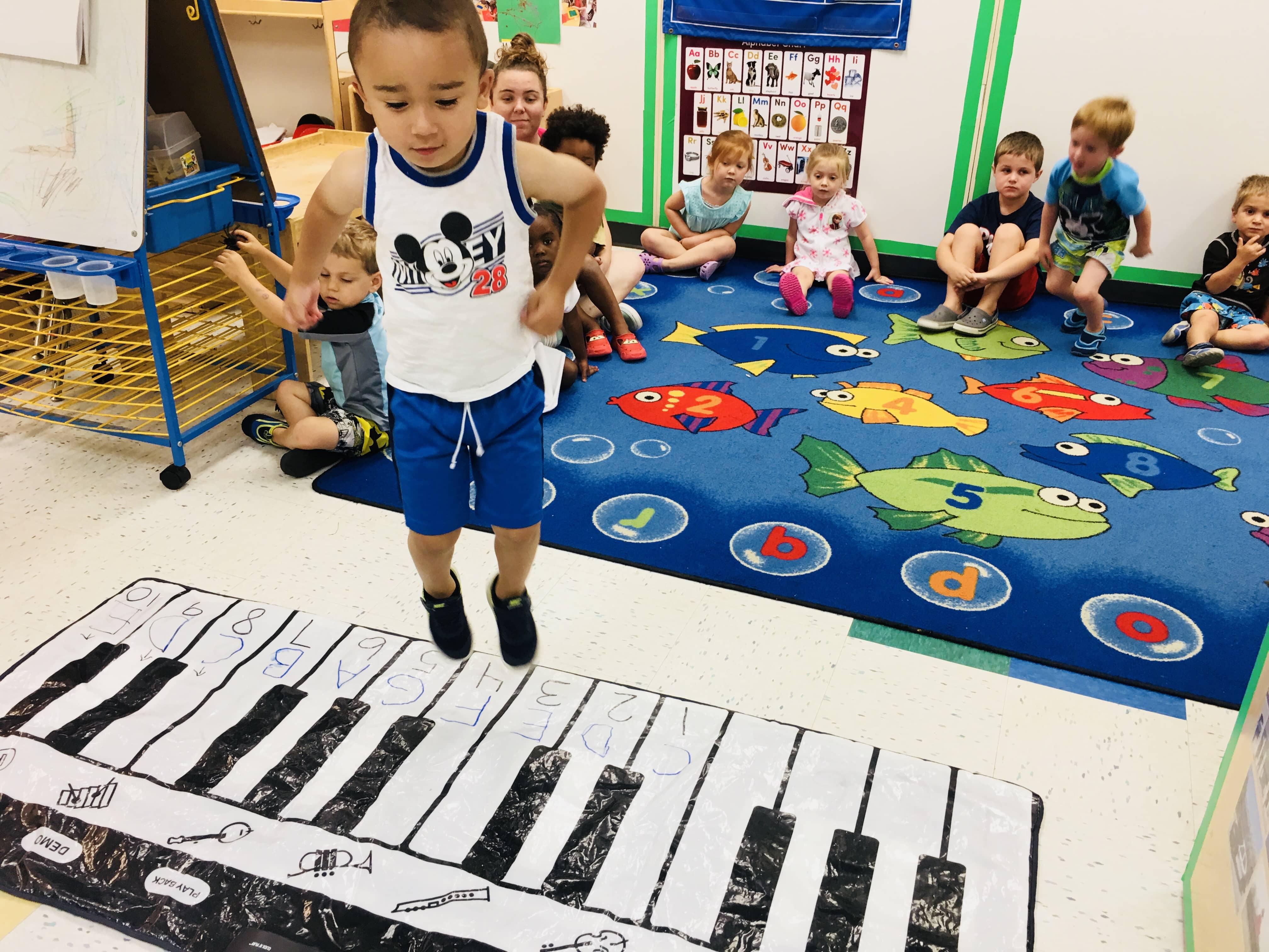 Boy Playing Floor Piano 2