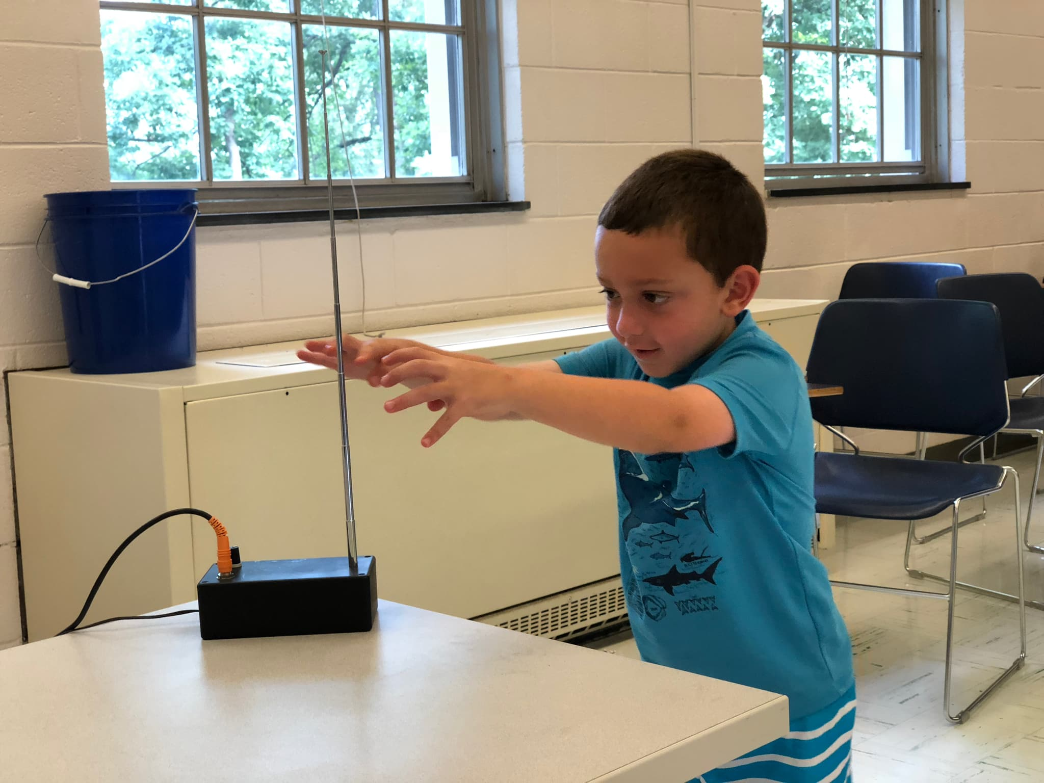 Boy playing theremin