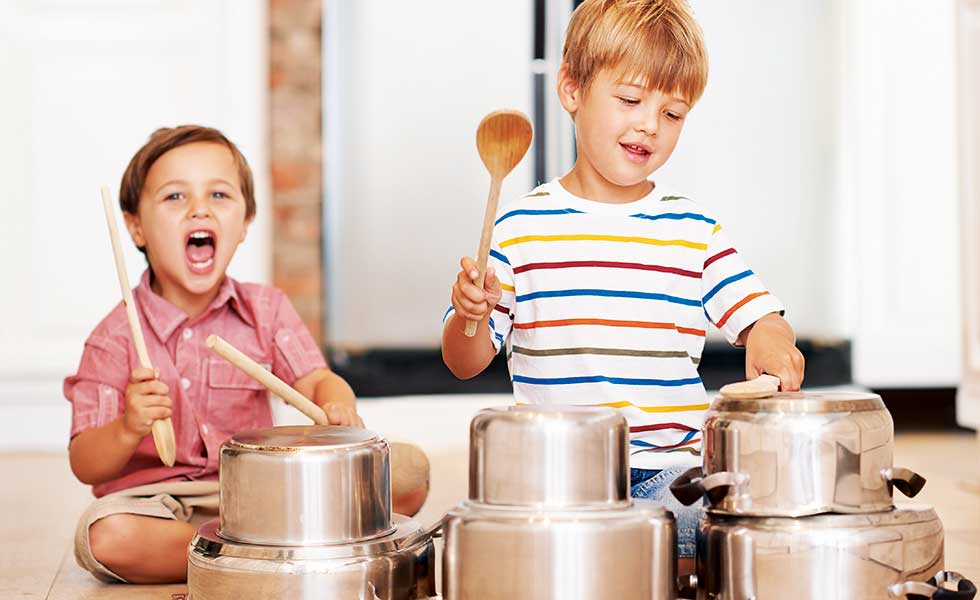 boys-hitting-pots-and-pans-with-wooden-spoons