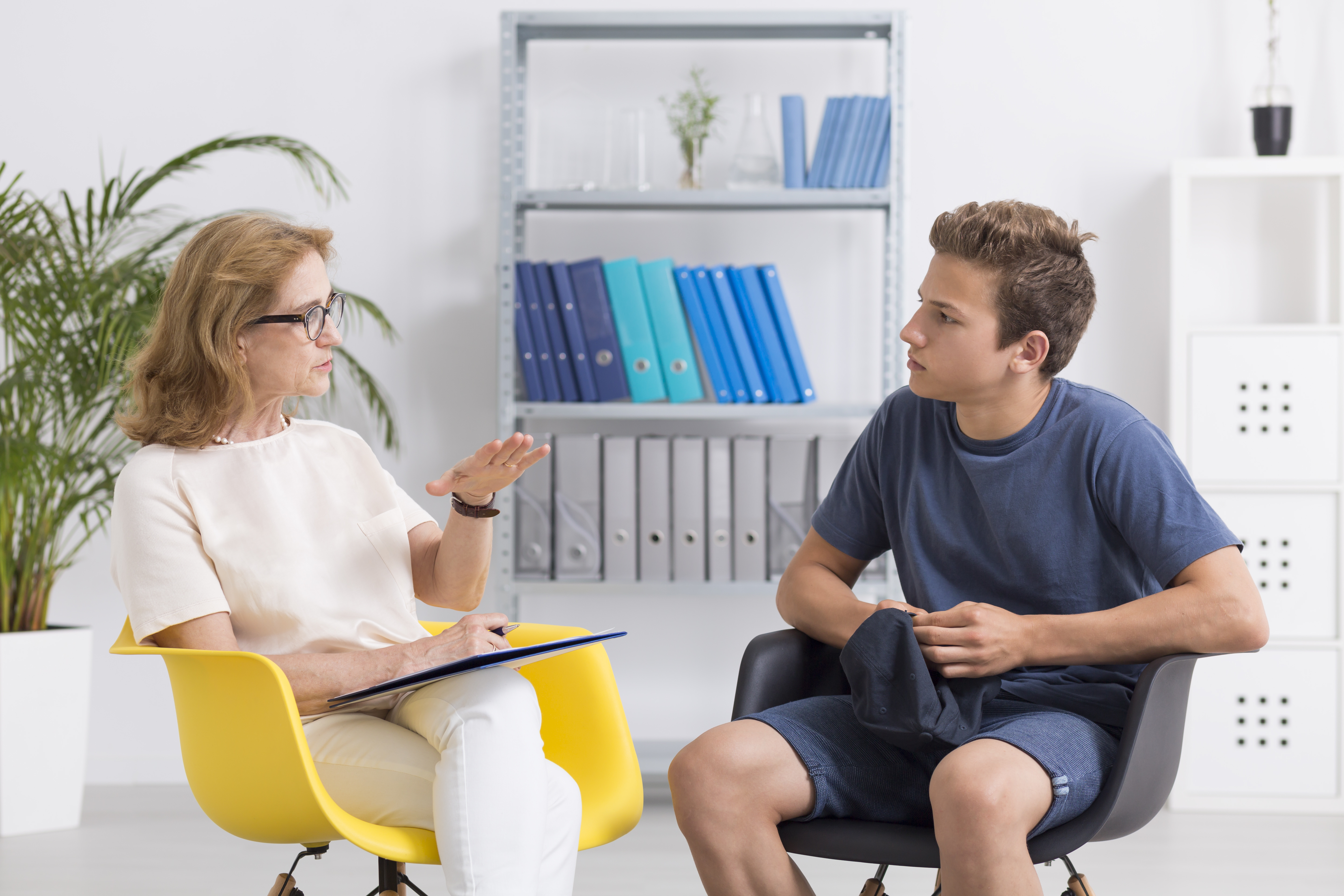 mental health therapist with client