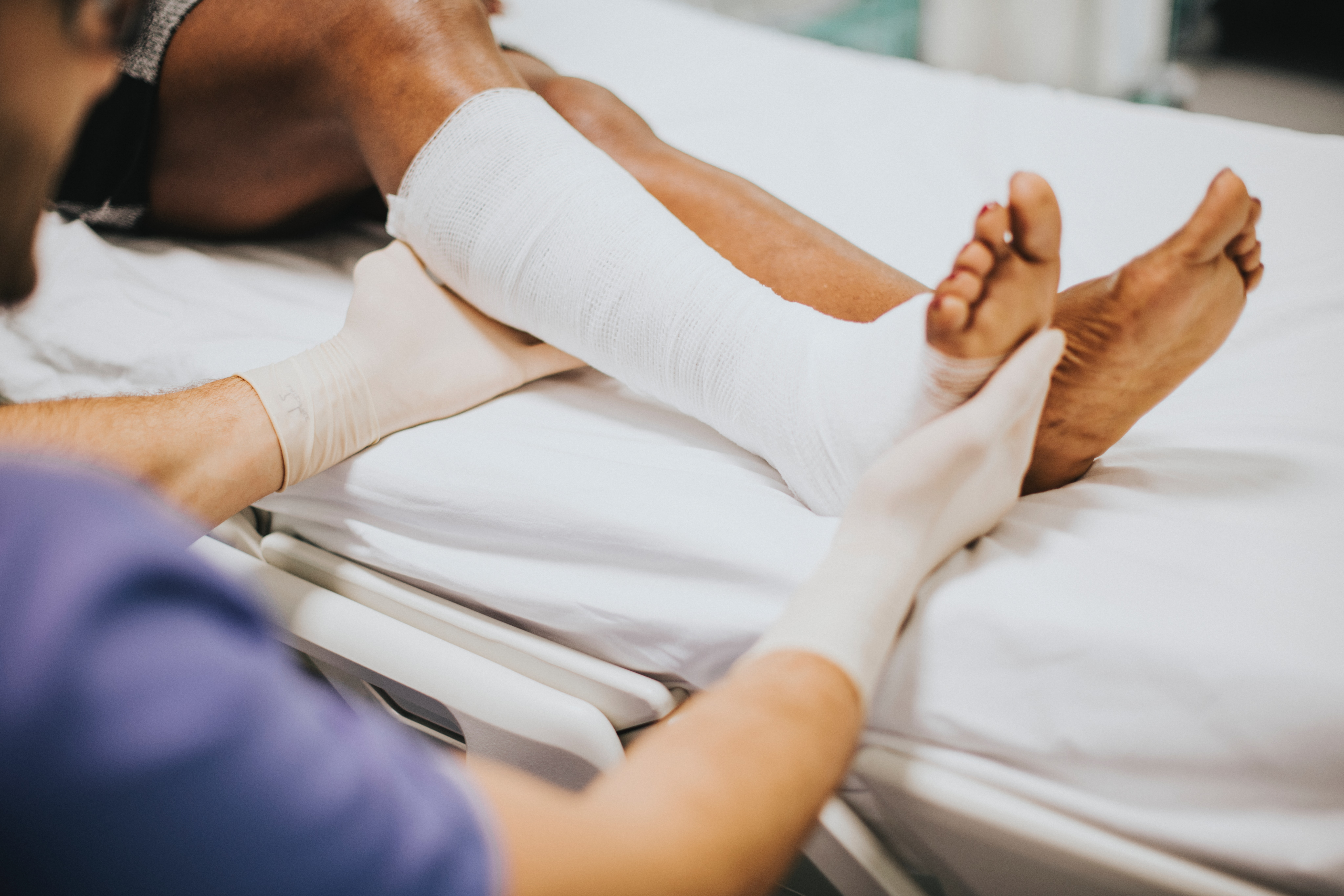 wrapped ankle medics hands
