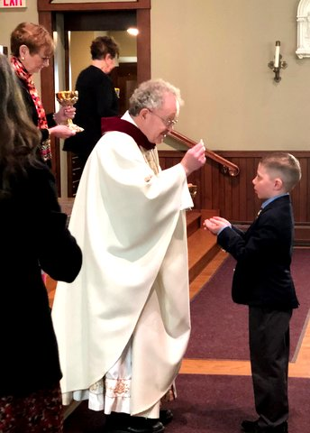 Receiving First Communion